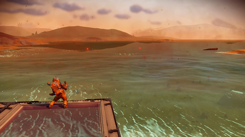 Traveller looks out across the water in No Man's Sky
